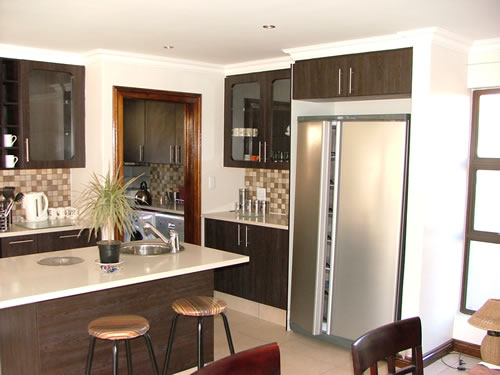 Small kitchen cupboards small flats and apartments for Kitchen island gauteng