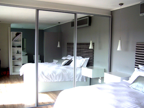 Image result for bedroom with mirrors on cupboard